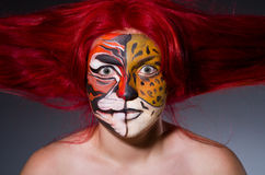 Woman with tiger face Royalty Free Stock Images