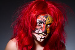 Woman with tiger face Stock Images