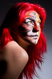 Woman with tiger face Stock Photos