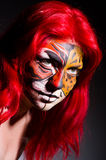 Woman with tiger face in halloween Stock Photos