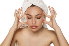 Woman tightening her face Stock Images
