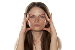 Woman tightening her face Royalty Free Stock Photos