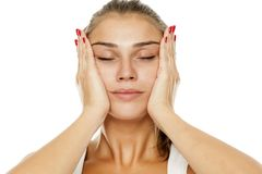 Woman tightening her face. Young woman tightening her face with her hands Royalty Free Stock Photos