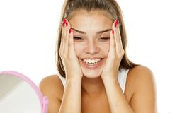 Woman tightening her face. Young smiling woman tightening her face with her hands Stock Photos