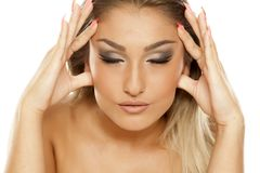 Woman tightening her face royalty free stock image