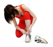 Woman tightening her jogging  Royalty Free Stock Images