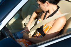Woman tightening her safety belt stock photography