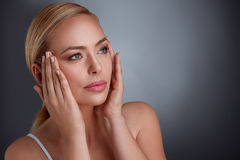 Woman tightening skin on face to make you look younger Royalty Free Stock Image
