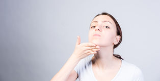 Woman Tilting her Head While Lifting her Chin Stock Images