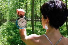 Woman of the time. Woman showing the time on a clock Stock Photography