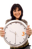 Woman time. Young smiling woman with a wall clock ehite isolate Stock Photo