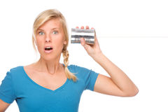 Woman with tin phone Stock Images