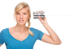 Woman with tin phone Royalty Free Stock Photos