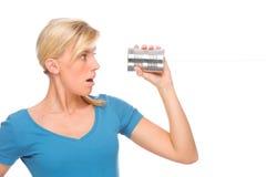 Woman with tin phone Stock Photos