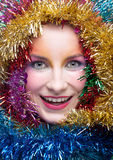 Woman in tinsel Christmas costume Royalty Free Stock Images