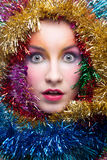 Woman in tinsel Christmas costume Stock Photo