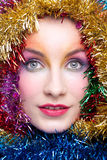 Woman in tinsel Christmas costume Royalty Free Stock Photos