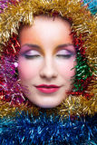 Woman in tinsel Christmas costume Stock Images