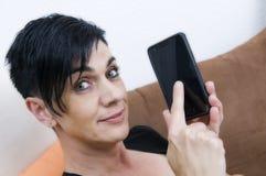 Woman tip at smart phone Stock Photos