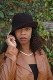 Woman tipping her hat. Beautiful African American woman tipping her hat royalty free stock images