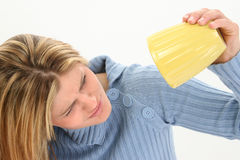 Woman tipping up beaker Royalty Free Stock Image