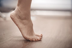 Woman tiptoeing Stock Images