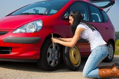 Woman with a tire breakdown in car Royalty Free Stock Photos