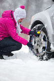 Woman with tire chains Stock Images