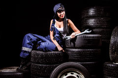 Woman in a tire service Stock Photography