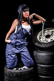 Woman in a tire service Royalty Free Stock Photos