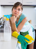 Woman tired during cleanup at kitchen Stock Images