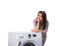 The woman tired after doing laundry isolated on white Royalty Free Stock Image