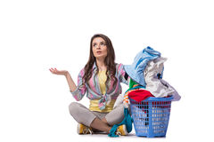 The woman tired after doing laundry isolated on white Stock Photos