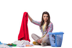 The woman tired after doing laundry isolated on white Royalty Free Stock Photography