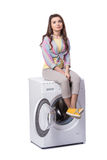 The woman tired after doing laundry isolated on white Stock Images