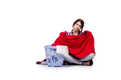 The woman tired after doing laundry isolated on white Royalty Free Stock Photo