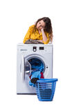 The woman tired after doing laundry isolated on white Royalty Free Stock Images