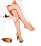Woman with tired feet Royalty Free Stock Images