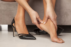 Woman with tired feet Royalty Free Stock Photos