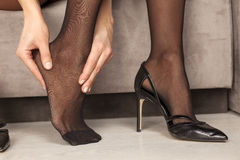 Woman with tired feet Stock Images