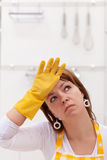 Woman tired of home chores Royalty Free Stock Image
