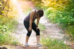 Woman tired while jogging, outdoor exercise. Healthy lifestyle concept royalty free stock photo