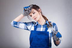 Woman tired after manual work Stock Photos