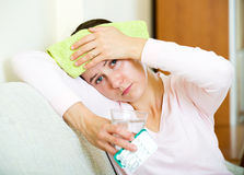 Woman tired of problems having headache Stock Image