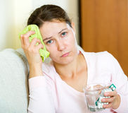 Woman tired of problems having headache Royalty Free Stock Photography