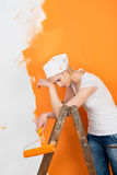Woman tired from renovating her apartment Royalty Free Stock Photos