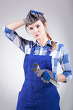 Woman tired of repairing Stock Image