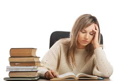 Woman tired because of studying Stock Images