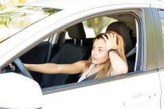 Woman tired of traffic jam. Upset caucasian woman got stuck in heavy traffic jam royalty free stock photos