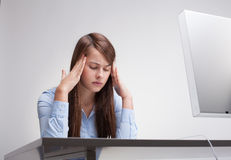 Woman tired at work Stock Image